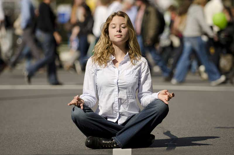 woman-meditating-busy-street-1.2