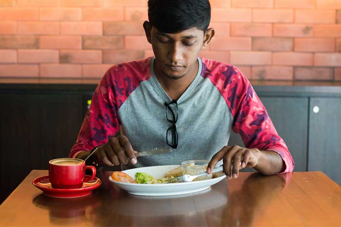 boy-eating-alone-at-table-1.2
