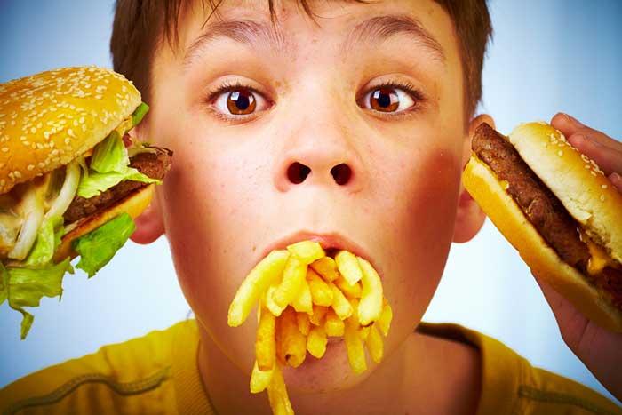boy-stuffing-food-1.2