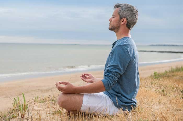 man-meditating-beach-1