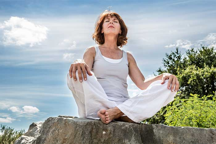 woman-meditating-outdoors-centered-2.2
