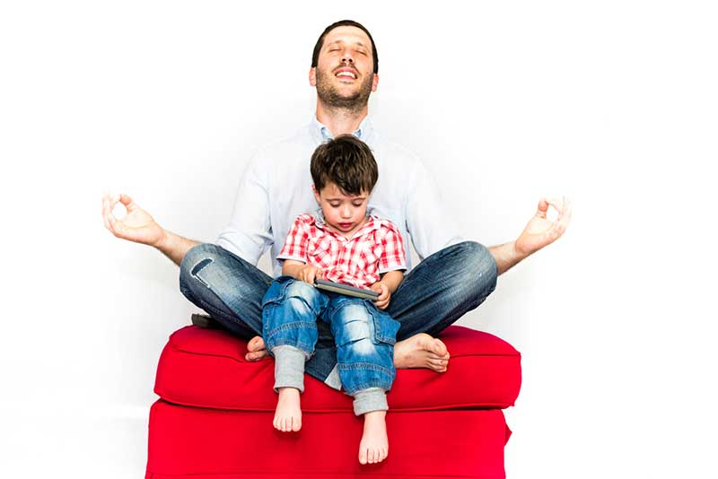father-meditating-kid-in-lap-1.2