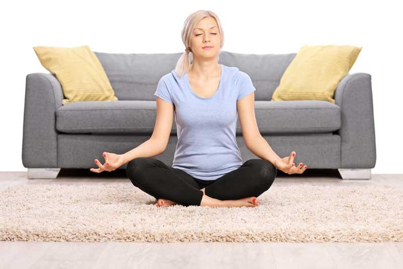 woman-med-livingroom-grey-sofa2