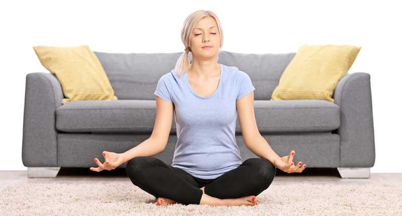 woman-med-livingroom-grey-sofa3
