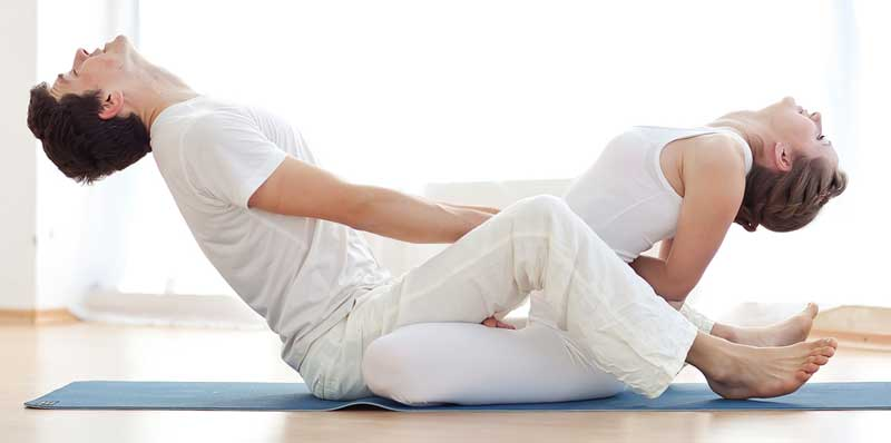 couple-in-white-doing-yoga-together-o