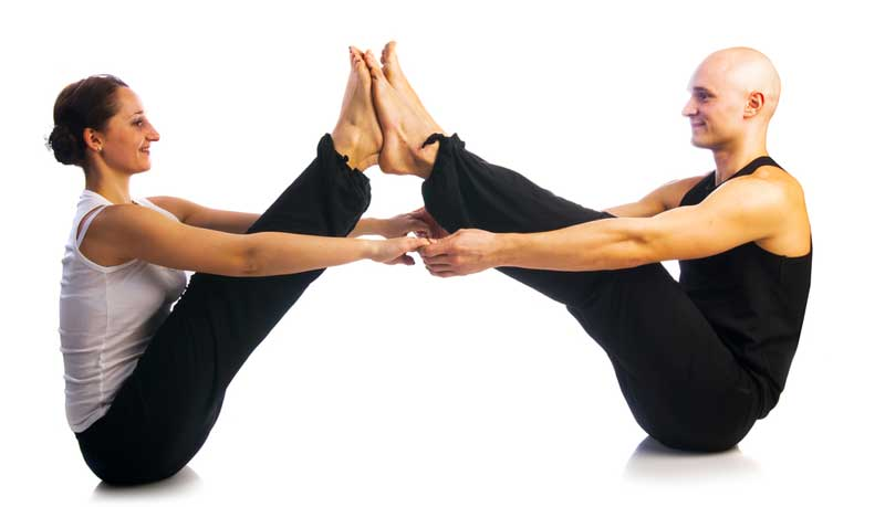 couple-in-yoga-position-with-feet-attached-o