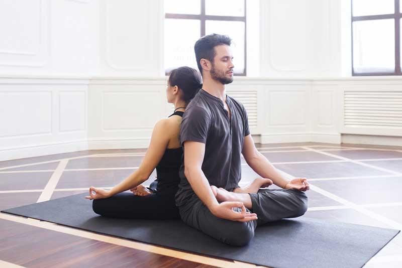 couple-meditating-back-to-back-o