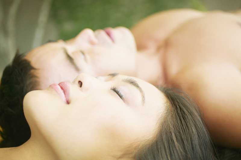 couple-meditating-lying-down-0