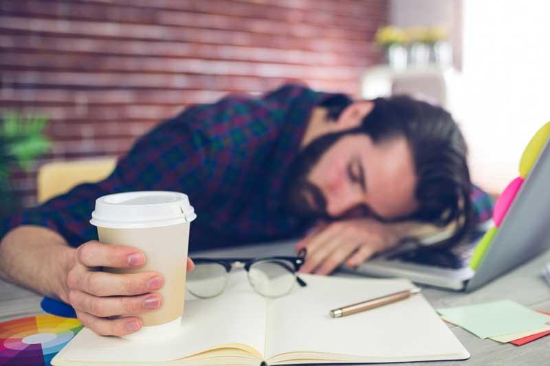 man-sleeping-at-desk-o