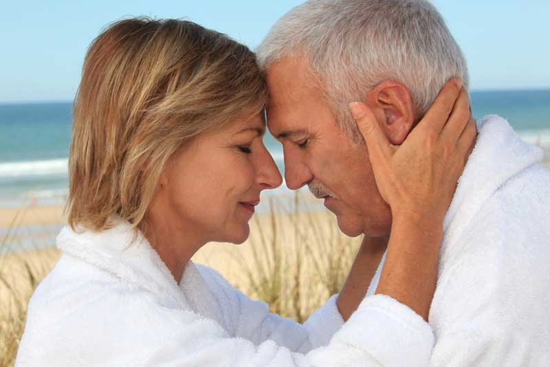 older-couple-meditating-together-face-to-face-o