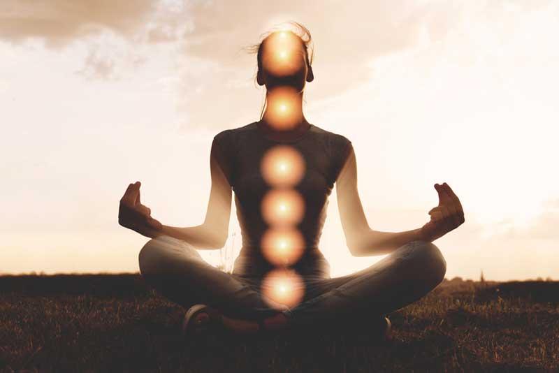 woman-meditating-with-chakras-highlighted-o