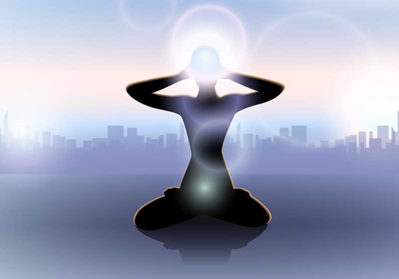 woman-silhouette-meditating-with-third-eye-glowing-o